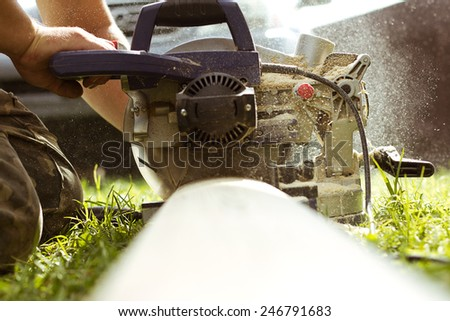 carpenter work with circular saw - stock photo