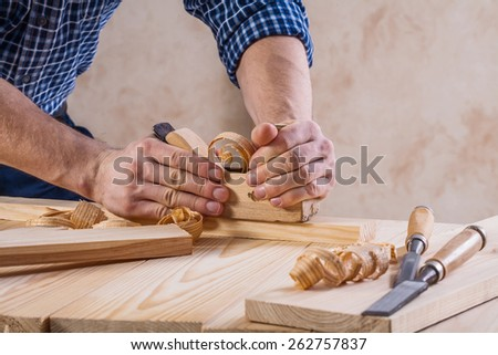 carpenter working with woodworkers plane very close up view construction concept  - stock photo