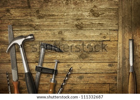 Carpentry hand tools set on old wooden background - stock photo