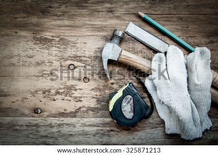 Carpentry tools on the wooden table. - stock photo