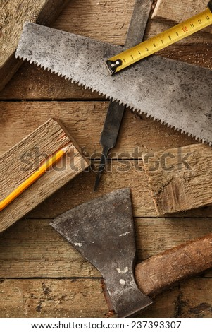 Carpentry tools on wooden surface - stock photo