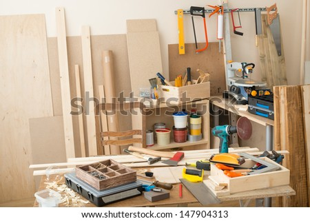 Carpentry workshop with tools and supplies - stock photo