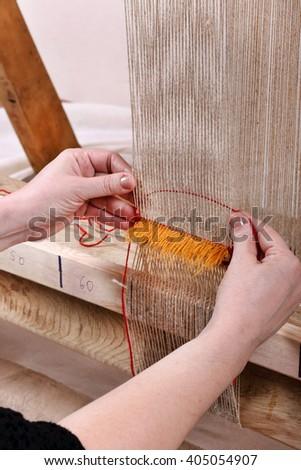 Carpet weaving process - stock photo