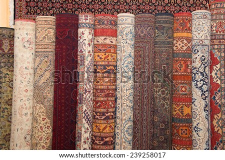 carpets and Kilims on display rolled up - stock photo