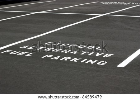 Carpool Alternative Fuel Parking space on new parking lot - stock photo