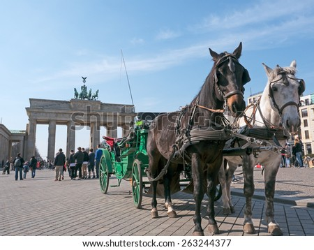 Carriage in front of the Brandenburg Gate in Berlin - stock photo