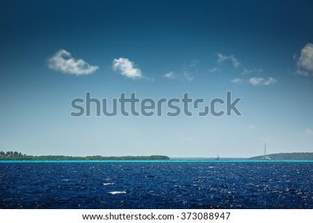 Carribean sea and beautiful tropical nature. View toward Saona island and sailing catamaran boats - stock photo