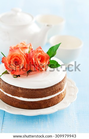 Carrot cake with cream cheese frosting, selective focus - stock photo