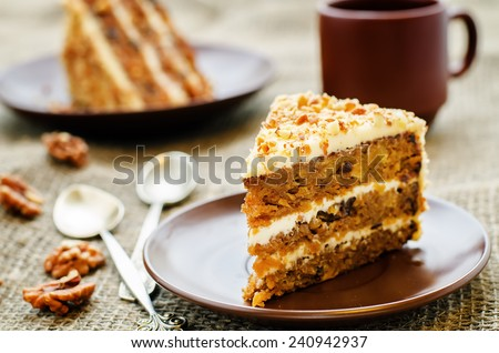carrot cake with walnuts, prunes and dried apricots on a dark background. tinting. selective focus - stock photo