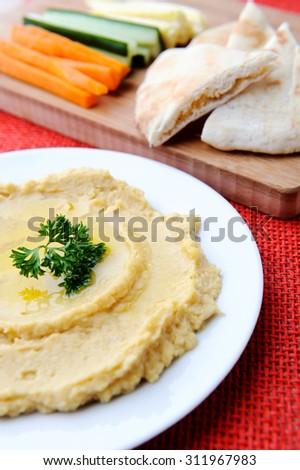 Carrot, cucumber and corn sticks with pita bread and humus/hummus - stock photo
