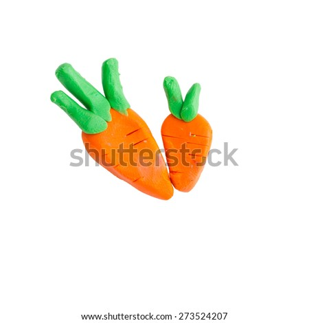carrot from plasticine - stock photo