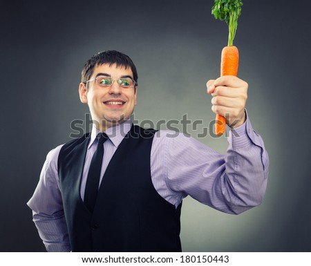 Carrot in hand - stock photo
