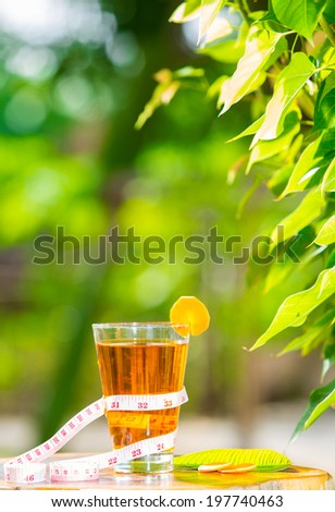 carrot juice  healthy fruit and tape measure placed on the table in the morning. - stock photo