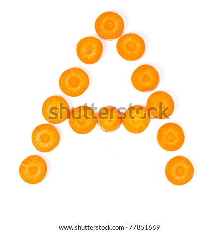 Carrot slices form letter symbolizing vitamin A - stock photo