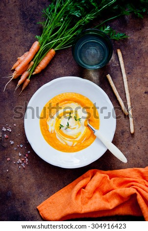 Carrot Soup on dark wooden background - stock photo