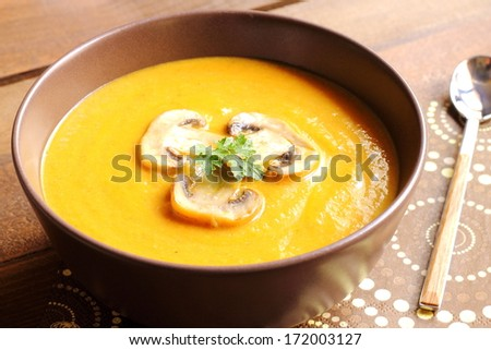 Carrot soup with mushrooms - stock photo