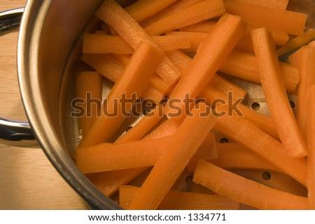 Carrot sticks in steamer. Orange slices of health! - stock photo
