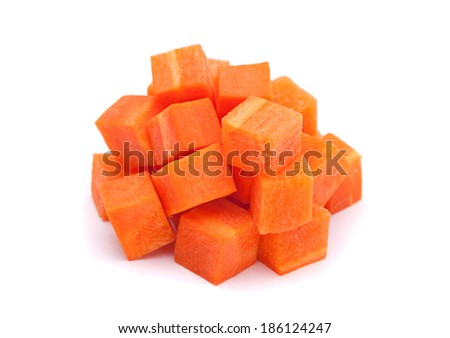 Carrot vegetable cube heap isolated on white background - stock photo