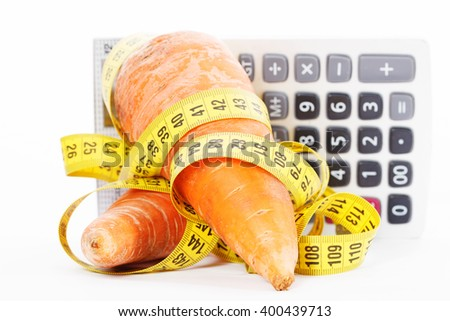 Carrot with a measure tape wrapped around and calculator isolated on a white background - stock photo