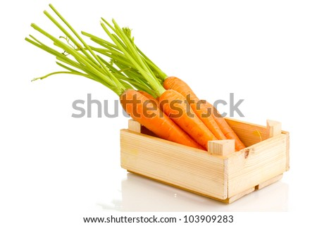 Carrots in crate isolated on white - stock photo