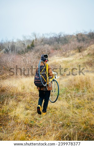 carry the bike - stock photo