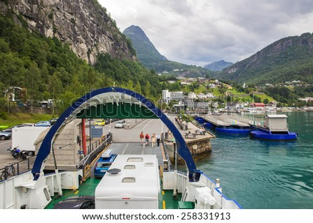Cars and people disembarking from the ferry boat linking Valldal to Geiranger, Norway fjords - stock photo