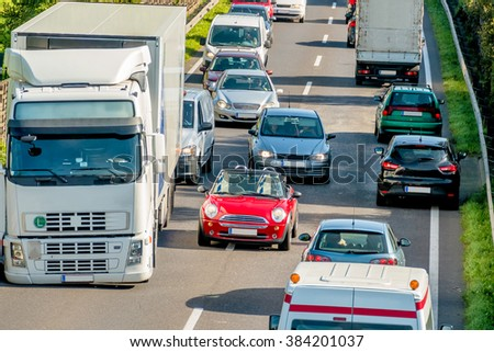 cars and trucks stuck in traffic - stock photo
