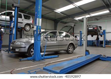 cars at modern car service - stock photo