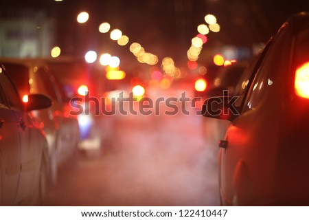 cars at night in a traffic jam in winter frost - stock photo