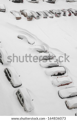 Cars covered by snow after snowstorm, top view - stock photo