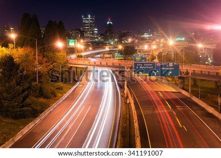 Cars create light trails in a long exposure over I-5 in Portland - stock photo
