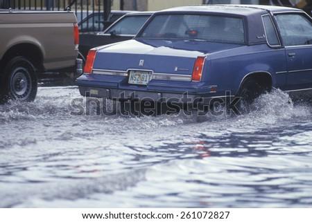 Cars Driving Through Flooded Street, Miami, Florida - stock photo