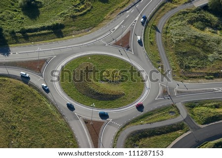 Cars in a roundabout - stock photo