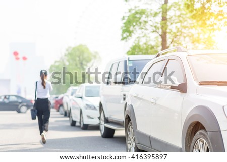 cars in parking lot - stock photo