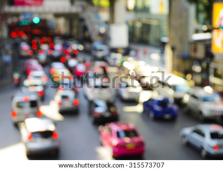 Cars in rush hour with blur bokeh - stock photo