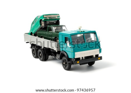 Cars in the back of toy truck on a white background - stock photo