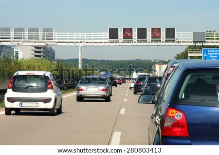 cars in traffic jam on highway, in Germany  - stock photo