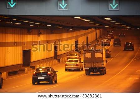 Cars in tunnel - stock photo