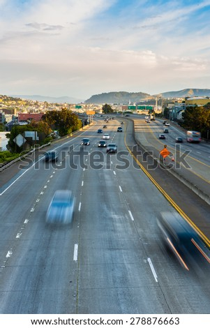 Cars moving on highway to Downtown San Francisco - stock photo