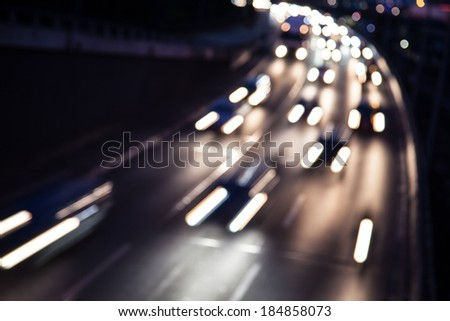 cars on a highway (bokeh effect) - stock photo