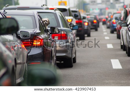 Cars on highway in traffic jam - stock photo