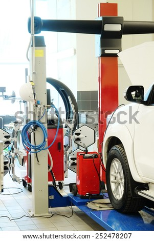 Cars on lifts in service station. Cars prepared to diagnosis and repair - stock photo