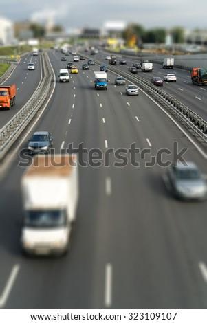 Cars on the freeway (tilt shift) - stock photo