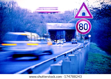 cars on the road with tunnel - stock photo