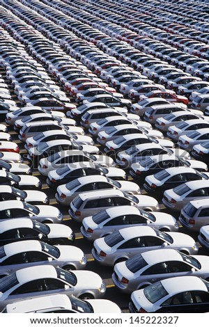 Cars parked in rows elevated view full frame - stock photo