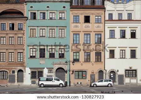Cars parked on the Old Town Market Place in Warsaw, Poland. Frame is made with tilt-shift lens. - stock photo