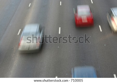 Cars passing by on the freeway - stock photo