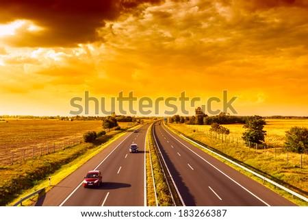 Cars speeding on a highway, Hungary - stock photo