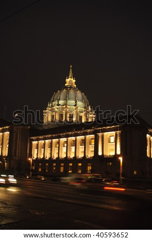 Cars streaking past the civic center in San Francisco on a winters evening - stock photo