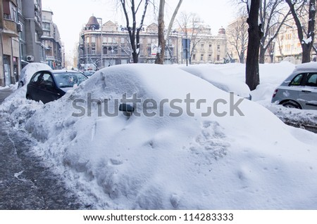cars under snow in Belgrade - stock photo